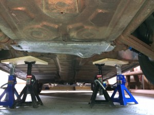 View of belly pan back under car