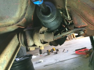 Fitting the dust boot onto the new tie rod
